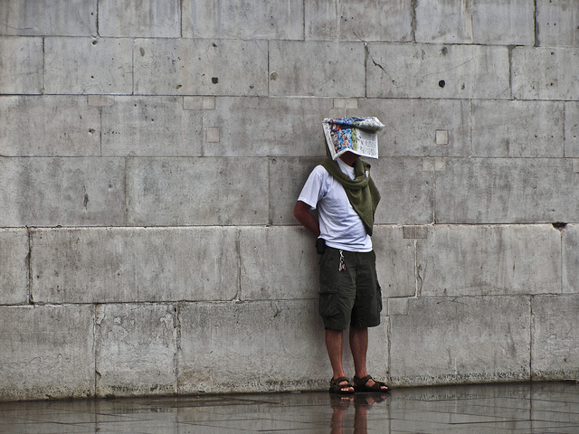 Newspaper Head by a Wall